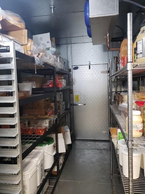 Walk in Freezer inside door.