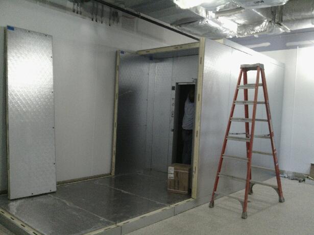 Installing walk in freezer walls.