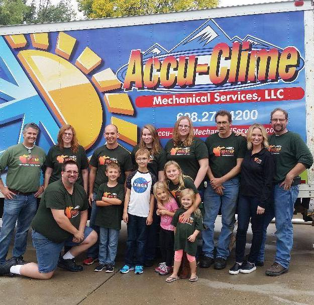 Accu-Clime Team and their spouses and children.